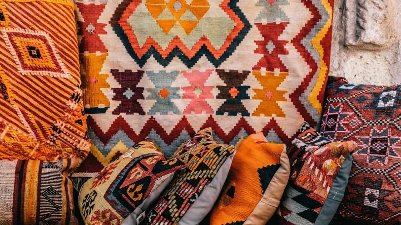 WHAT DO THE SIGNS AND SYMBOLS ON VARIOUS ANTIQUE CARPETS AND RUGS MEANING